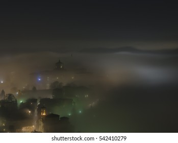 Bergamo - Old city (CittË? Alta). One of the beautiful city in Italy. Lombardia. The fog rises from the plains and wrap all the old city by creating lighting effects.