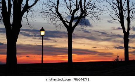 Bergamo, the old city. The old walls. Lombardy, Italy. Silhouette of light pole during the sunset