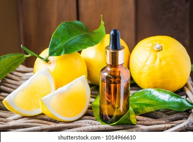 Bergamot citrus fruit essential oil, aromatherapy oil natural organic cosmetic on rustic wood background.