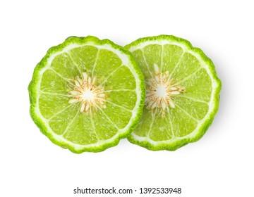 bergamot or kaffir slice with seeds isolated on white background