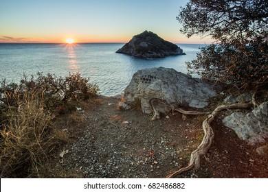 bergeggi isle in savona italy on a blue sky background and gorgeous sea