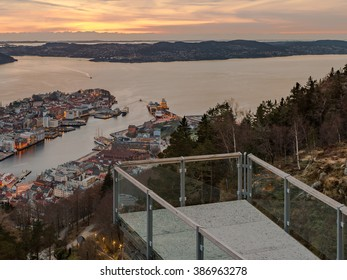 Bergen City, Scenic Aerial View Panorama harbour Cityscape under Dramatic Sky at sunset summer from Top of Mount Floyen Glass Balcony Viewpoint mountain in Norway