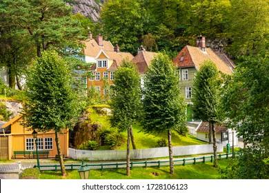 Bergen, Hordaland / Norway - 2019/09/06: Reconstructed XIX century Norwegian city street with wooden houses in Old Bergen Museum - Gamle Bergen Museum - heritage park
