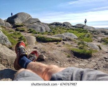 Bergen, Norway - 07.05.2017: A man resting after reaching a summit in Norway in nice weather