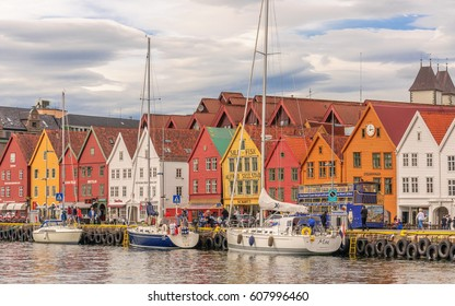 BERGEN, NORWAY - 2014 JUN 06: The pedestrian area near the Hanseatic Wharf, which includes UNESCO World Heritage Site with shops and open-air cafes. Bryggen street in Bergen - architecture background