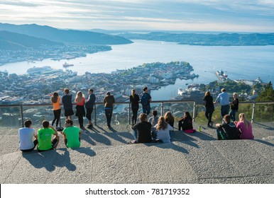 BERGEN, NORWAY - 23 SEPTEMBER 2017: Tourists admire the view from Floyen mountain over the city of Bergen, Norway