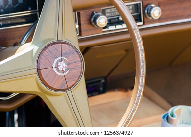 BERGEN, NORWAY - 4/29/18: Close up interior view of the steering wheel and dashboard gauges of a 1976 Cadillac Eldorado convertible, parked in a mountain tourist area during an amcar owners meeting.
