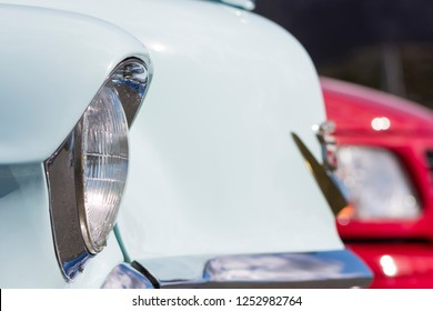 BERGEN, NORWAY - 4/29/18: Close up macro side view of the circular headlight of a 1954 Cadillac Eldorado convertible during a classic american car owners meeting.