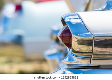 BERGEN, NORWAY - 4/29/18: Close up macro side view of the conical shaped tail light of a 1954 Cadillac Eldorado convertible with blurry background during a classic american car owners meeting.