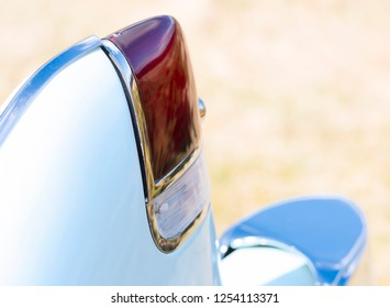 BERGEN, NORWAY - 4/29/18: Close up macro side view of the tail light and fin  of a 1954 Cadillac Eldorado convertible during a classic american car owners meeting.