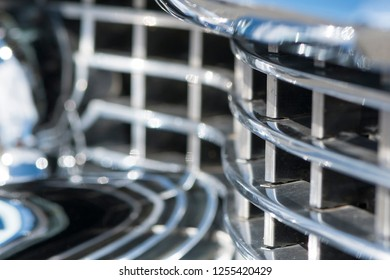 BERGEN, NORWAY - 4/29/18: Close up macro view of the chrome grill and weird bumper mirror reflections on a 1954 Cadillac Eldorado convertible during a classic american car owners meeting.
