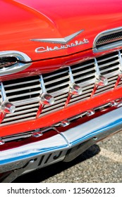BERGEN, NORWAY - 4/29/18: Close up macro view of the chrome grill and emblem of a 1959 Chevrolet Impala, parked in a mountain tourist area during a classic american car owners meeting.