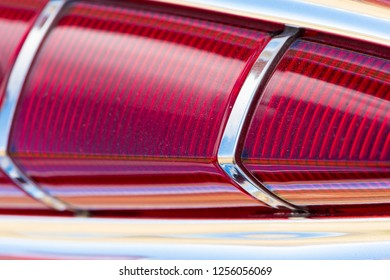 BERGEN, NORWAY - 4/29/18: Close up macro view of the tail light of a 1959 Chevrolet Impala, parked in a mountain tourist area during a classic american car owners meeting.