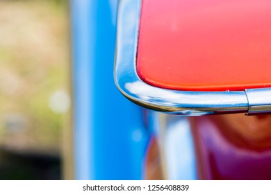 BERGEN, NORWAY - 4/29/18: Close up  macro view of the shiny chrome-fitted tail fin of a 1959 Chevrolet Impala, parked during an amcar owners meeting.