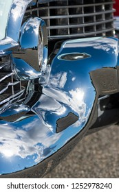 BERGEN, NORWAY - 4/29/18: Close up side view of the chrome grill, bumper and dagmar elements of a 1954 Cadillac Eldorado convertible during a classic american car owners meeting.