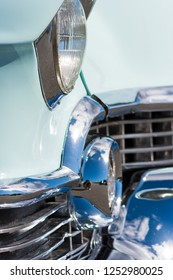 BERGEN, NORWAY - 4/29/18: Close up side view of the chrome grill, headlight, bumper and dagmar elements of a 1954 Cadillac Eldorado convertible during a classic american car owners meeting.