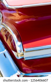 BERGEN, NORWAY - 4/29/18: Close up  top side view of the tail lights, shiny chrome metal trunk fitting element and back bumper of a 1959 Chevrolet Impala, during an amcar owners meeting.