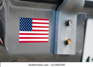 BERGEN, NORWAY - 4/29/18: Close up  view of the american flag on the bumper of a 1981-1985 Chevrolet Caprice Classic California Highway Patrol vehicle during a classic american car owners meeting.