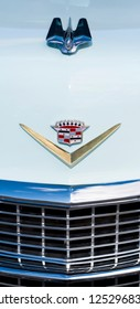 BERGEN, NORWAY - 4/29/18: Close up view of the emblem and part of the chrome grill of a 1954 Cadillac Eldorado, parked in a mountain tourist area during a classic american car owners meeting.