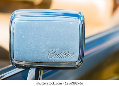 BERGEN, NORWAY - 4/29/18: Close up view of the emblem on the side mirror of a 1976 Cadillac Eldorado convertible, parked in a mountain tourist area during a classic american car owners meeting.