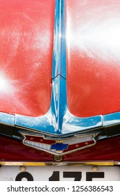 BERGEN, NORWAY - 4/29/18: Close up  view of the emblem above trunk lock of a 1959 Chevrolet Impala, parked among other classic cars in a mountain tourist area during an amcar owners meeting.
