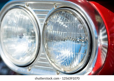 BERGEN, NORWAY - 4/29/18: Close up  view of the headlights of a 1959 Chevrolet Impala, parked among other classic cars in a mountain tourist area during an amcar owners meeting.