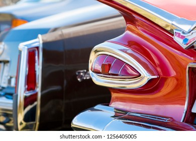 BERGEN, NORWAY - 4/29/18: Close up  view of the tail lights, shiny chrome metal trunk fitting element and back bumper of a 1959 Chevrolet Impala, during an amcar owners meeting.