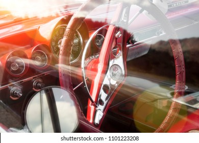 BERGEN, NORWAY - 4/29/18: Detail view of the red leather steering wheel of a 1959 Chevrolet Impala during an american car owners meeting on a sunny spring day in the mountain.