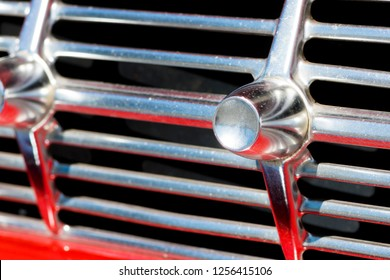 BERGEN, NORWAY - 4/29/18: Extreme close up macro view of the  shiny and stylish chrome grill of a 1959 Chevrolet Impala, parked in a mountain tourist area during a classic american car owners meeting