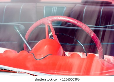 BERGEN, NORWAY - 4/29/18: Front glass through view of the steering wheel and the automatic transmission shifter on a 1959 Chevrolet Impala,  during a classic american car owners meeting.