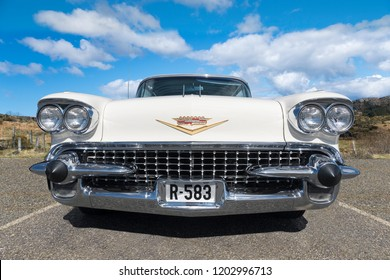 BERGEN, NORWAY - 4/29/18: Full frontal low angle view of a 1958 Cadillac De Ville, parked in a mountain tourist area during a classic american car owners meeting.
