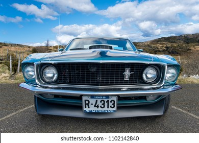 BERGEN, NORWAY - 4/29/18: Full low front view of a 1969 Ford Mustang,  parked in a mountain tourist area during an amcar owners meeting.