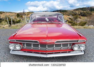 BERGEN, NORWAY - 4/29/18: Full top front view of a red 1959 Chevrolet Impala, parked in a mountain tourist area during an amcar owners meeting.