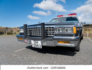 BERGEN, NORWAY - 4/29/18: Low angle front side view of a 1985 Chevrolet Caprice restored as California highway patrol police car, parked  in a mountain tourist area during an amcar owners meeting.
