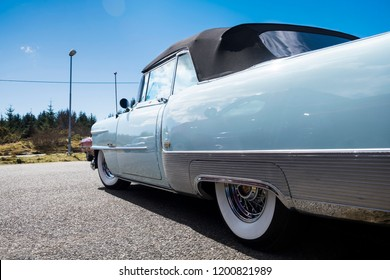 BERGEN, NORWAY - 4/29/18: Low angle side view of a 1954 Cadillac Eldorado convertible, parked in a mountain tourist area during a classic american car owners meeting.