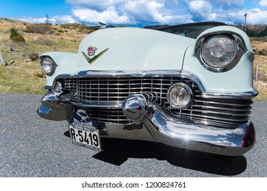BERGEN, NORWAY - 4/29/18: Low angle front side view of a 1954 Cadillac Eldorado convertible, parked in a mountain tourist area during a classic american car owners meeting.