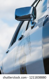 BERGEN, NORWAY - 4/29/18: Side view of the passenger door and mirror of a 1981-1985 Chevrolet Caprice Classic California Highway Patrol vehicle during a classic american car owners meeting.