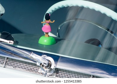 BERGEN, NORWAY - 4/29/18: View of the steering wheel and dashboard with hula girl, plush dice and sunglasses in a 1954 Cadillac Eldorado convertible,  during a classic american car owners meeting.