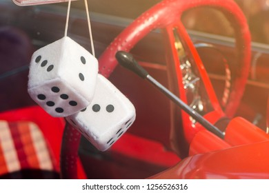 BERGEN, NORWAY - 4/29/18: View of the steering wheel and shifter with  plush dice hanging from the back mirror on a 1959 Chevrolet Impala,  during a classic american car owners meeting.
