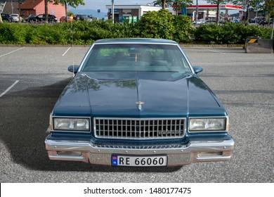 Bergen, Norway -  8/3/19: Full frontal view of a 1987-1989 3rd gen Chevrolet Caprice 4 door sedan parked during an amcar owners meeting.