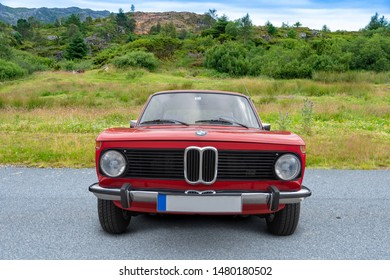 Bergen, Norway -  8/3/19: Full frontal view of a german classic - 1975-1977 BMW model 1502 2 door, parked outside in a mountain tourist area.