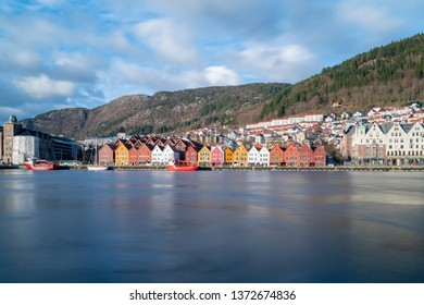 Bergen, Norway April 03 2019: colorful houses of Bryggen Wharf/Tysk Bryggen, old hanseatic quarter with brightly colored historic wooden houses and shops in spring, unesco world heritage site