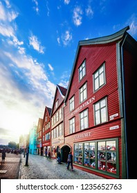 Bergen, Norway - August 1, 2018: Tourists visiting and enjoying the Old Town pier architecture in Bryggen - Hanseatic wharf, Bergen, Norway.