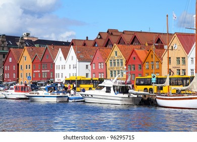BERGEN, NORWAY - AUGUST 14: Tourists at famous Bryggen street on August 14, 2010 in Bergen, Norway. Bergen is one of most famous cruise travel destinations in Europe - 7th in 2009 with 260 ship calls.