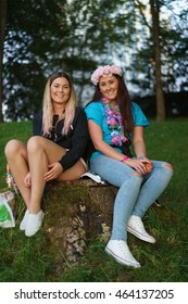BERGEN, NORWAY - AUGUST 19, 2015: Norwegian girls in the Nordnes Park at dusk. The park is located near the centre of the city of Bergen on the northwestern end of the Nordnes peninsula.