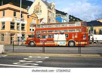 BERGEN, NORWAY - AUGUST 8, 2010: Red double-decker touring across Bergen downtown.