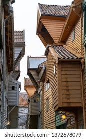 Bergen, Norway: bright colorful wooden houses of Bryggen Wharf / Tysk Bryggen historic old hanseatic district, Unesco World Heritage Site, restaurants, cafes and shops