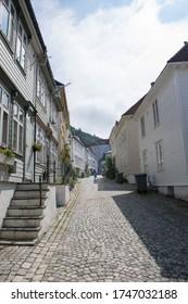 Bergen / Norway - July 2019: Bryggen street in Bergen Norway - architecture background. View of historical buildings in Bryggen.