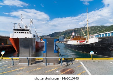 BERGEN, NORWAY - JULY 28, 2018: Ships moored at the port of Bergen. The port has 5,500 meters of quays with draft at 11 meters.