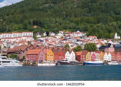BERGEN, NORWAY - JULY 28, 2018: View of historical buildings in Bryggen- Hanseatic wharf. Bryggen has been on the UNESCO World Heritage List since 1979.